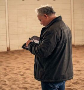 PICTURED : Dr. Kevin Keagan checking on trial data from the lunging trial being performed.